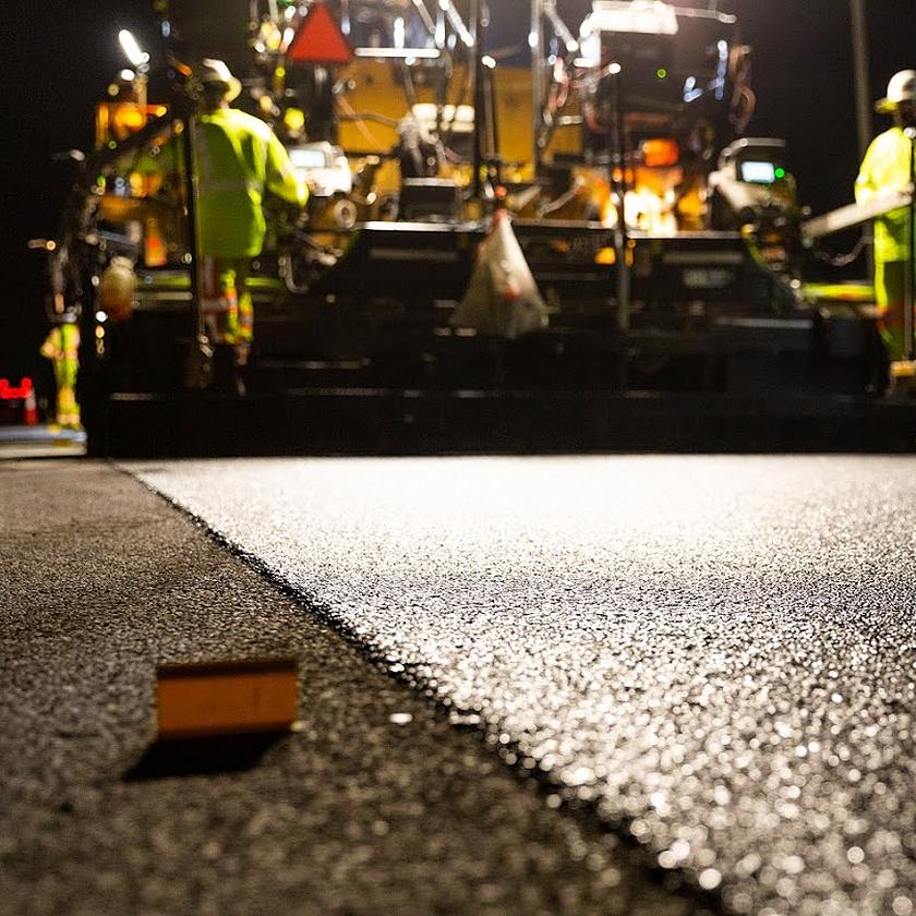 road paver at night